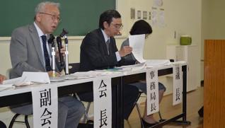 内容を説明する二木会長(左)
